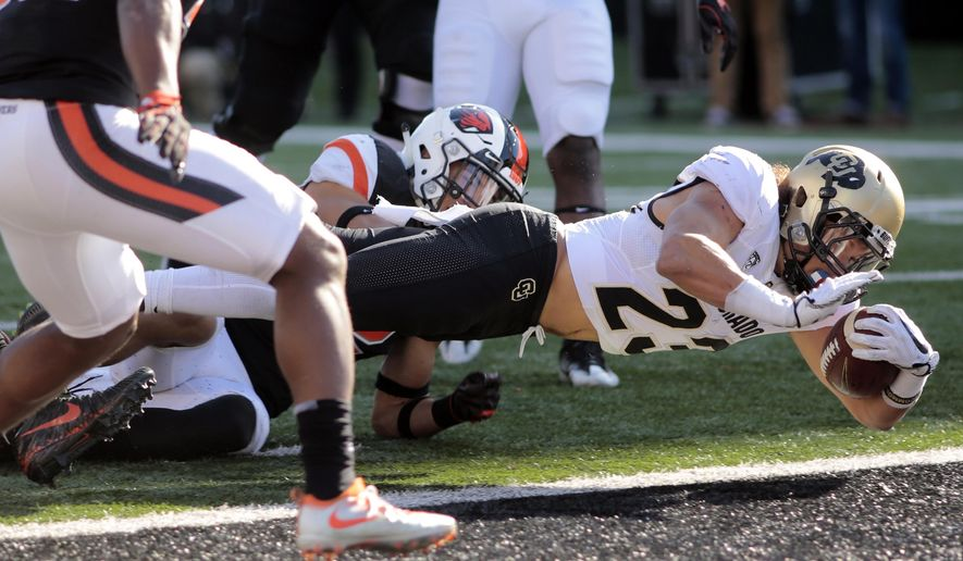 Colorado running back Phillip Lindsay (23) dives into the end zone for a touchdown during the second half an NCAA college football game against Oregon State in Corvallis, Ore., Saturday, Oct. 14, 2017. (AP Photo/Timothy J. Gonzalez)