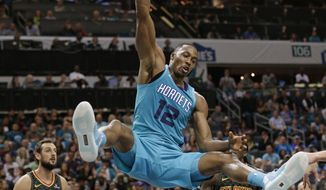 Charlotte Hornets' Dwight Howard (12) dunks against the Atlanta Hawks during the second half of an NBA basketball game in Charlotte, N.C., Friday, Oct. 20, 2017. (AP Photo/Chuck Burton)