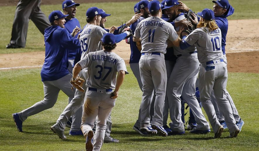 The Los Angeles Dodgers players celebrate after Game 5 of baseball's National League Championship Series against the Chicago Cubs, Thursday, Oct. 19, 2017, in Chicago. The Dodgers won 11-1 to win the series and advance to the World Series. (AP Photo/Charles Rex Arbogast)