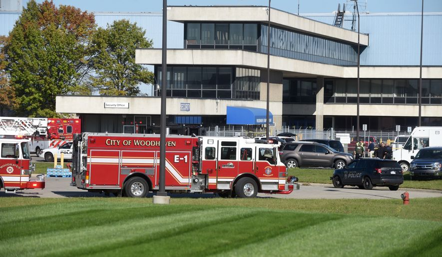 Woodhaven fire department personnel remain on the scene of a shooting at a Ford Motor factory Friday Oct. 20, 2017, in Woodhaven, Mich. (Max Ortiz/Detroit News via AP)