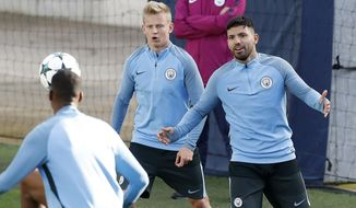 Manchester City's Sergio Aguero, left, attends a training session with his teammates at the City Football Academy, Manchester, England, Monday Oct. 16, 2017. (Martin Rickett/PA via AP)