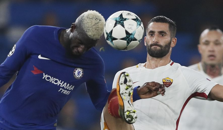 Chelsea's Tiemoue Bakayoko, left, challenges for the ball with Roma's Maxime Gonalons during the Champions League group C soccer match between Chelsea and Roma at Stamford Bridge stadium in London, Wednesday, Oct. 18, 2017. (AP Photo/Kirsty Wigglesworth)