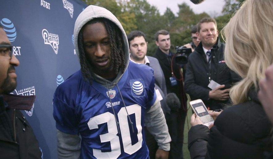 Los Angeles Rams' running back Todd Gurley finishes speaking with the media following a training session at Pennyhill Park Hotel in Bagshot, England, Friday Oct. 20, 2017. The Los Angeles Rams are preparing for an NFL regular season game against the Arizona Cardinals in London on Sunday. (AP Photo/Tim Ireland)