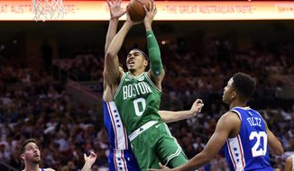 Boston Celtics' Jayson Tatum (0) drives to the basket past Philadelphia 76ers' Dario Saric in the first half of an NBA basketball game, Friday, Oct. 20, 2017, in Philadelphia. (AP Photo/Michael Perez)