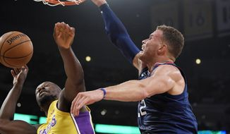 Los Angeles Clippers forward Blake Griffin, right, dunks on Los Angeles Lakers forward Julius Randle during the first half of an NBA basketball game, Thursday, Oct. 19, 2017, in Los Angeles. (AP Photo/Mark J. Terrill)