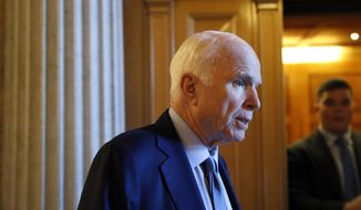 Sen. John McCain, R-Ariz., speaks to reporters Thursday, Oct. 19, 2017, on Capitol Hill in Washington. (AP Photo/Jacquelyn Martin) ** FILE **