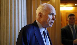 Sen. John McCain, R-Ariz., speaks to reporters Thursday, Oct. 19, 2017, on Capitol Hill in Washington. (AP Photo/Jacquelyn Martin)