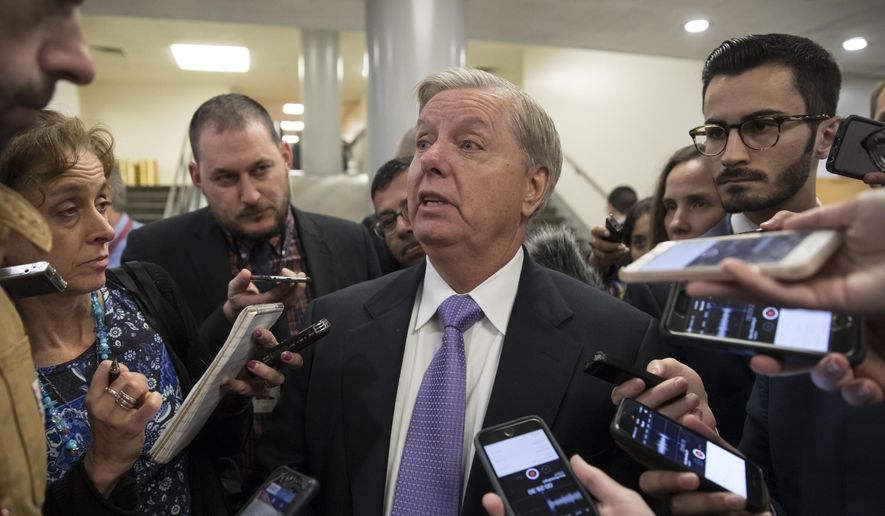 Sen. Lindsey Graham, R-S.C., chairman of the Senate Judiciary Subcommittee on Crime and Terrorism, is questioned by reporters, at the Capitol in Washington, Thursday, Oct. 19, 2017. (AP Photo/J. Scott Applewhite) ** FILE **