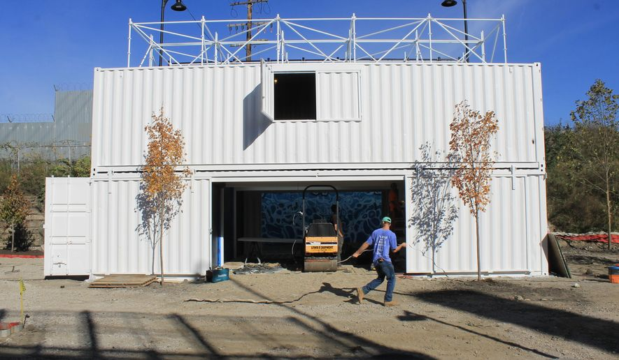 This photo provided by Detroit RiverFront Conservancy shows the Dequindre Cut Freight Yard project in Detroit on Thursday, Oct. 19, 2017.  The new retail and entertainment gathering space made of repurposed shipping containers is scheduled to open in the spring of 2018.  (Marc Pasco/ Detroit RiverFront Conservancy via AP)