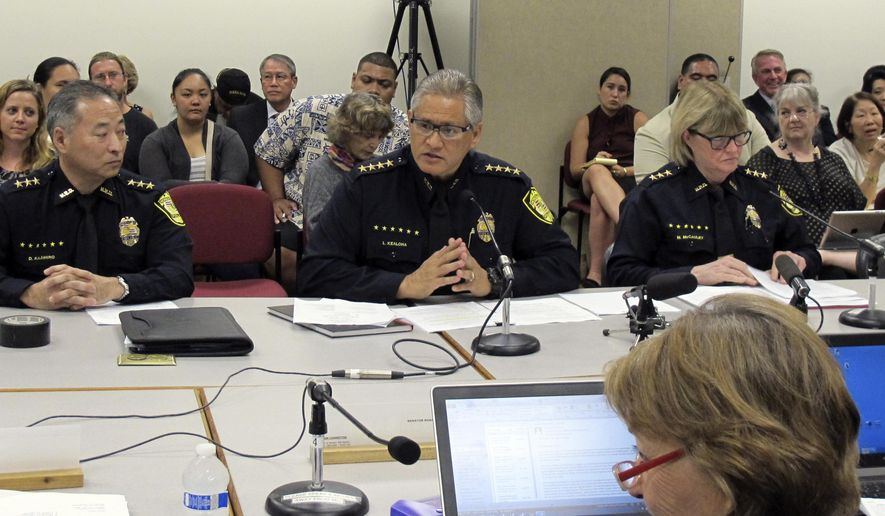 FILE- In this Sept. 30, 2014, file photo, Honolulu Police Chief Louis Kealoha, center, addresses Hawaii lawmakers during hearing in Honolulu. Kealoha the former Honolulu police chief who retired amid a federal investigation into department-wide corruption has been indicted and arrested. An assistant U.S. attorney says Kealoha and his wife, Katherine, a deputy city prosecutor, surrendered to federal authorities outside their home Friday, Oct. 20, 2017. What started as a curious case about a stolen mailbox has led to arrests of current and former officers accused of falsifying documents and altering evidence. (AP Photo/Jennifer Sinco Kelleher, File)