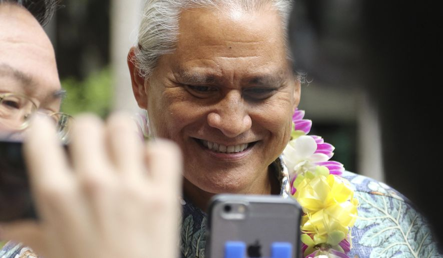 Former Honolulu Police Chief Louis Kealoha leaves federal court in Honolulu, Friday, Oct. 20, 2017. Kealoha and his wife, a city prosecutor, have pleaded not guilty to federal corruption charges. U.S. Magistrate Judge Richard Puglisi on Friday released Louis and Katherine Keahola on $100,000 bond each. They entered the pleas Friday after a federal grand jury indicted both of them in a public corruption case. Authorities claim the couple used their positions to bilk clients and relatives out of hundreds of thousands of dollars to fund their lavish and overextended lifestyle and then used their power to target anyone who threatened them. (AP Photo/Caleb Jones)