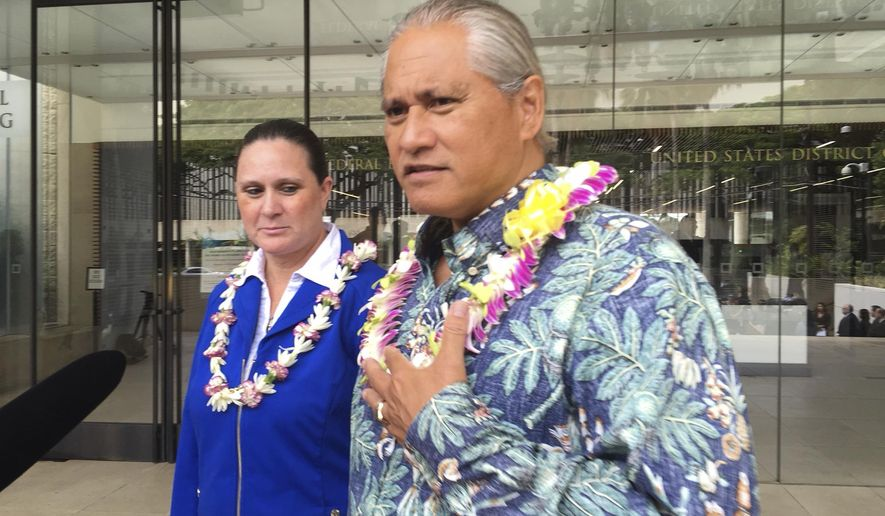 Former Honolulu police chief Louis Kealoha, right, and his wife, city deputy prosecutor Katherine Kealoha speak to media outside U.S. District Court in Honolulu on Friday, Oct. 20, 2017. The Kealohas and current and former police officers conspired to frame the couple's relative for stealing a mailbox to discredit him in a family financial dispute, according to a federal indictment released Friday. (AP Photo/Audrey McAvoy)