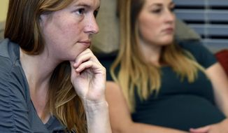 In this Tuesday, Oct. 10, 2017 photo, Rachel Harris listens as Hypnobabies instructor Bonnie Baker goes over an introduction to her class at a home in Kaysville, Utah. The class is made up of six three-hour sessions teaching a childbirth method involving a deep state of relaxation. (Sarah Welliver/Standard-Examiner via AP)