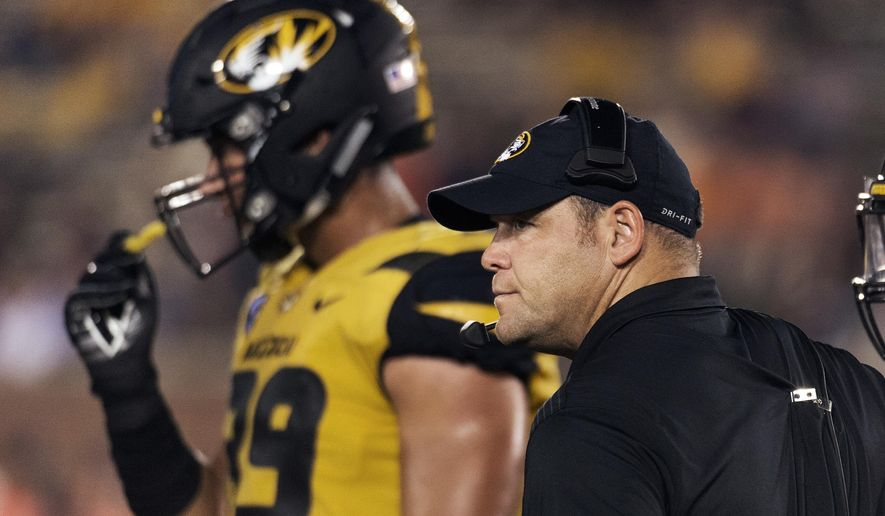 FILE - In this Sept. 23, 2017, file photo,Missouri head coach Barry Odom watches his team play during the third quarter of an NCAA college football game against Auburn Saturday,, in Columbia, Mo. Odom is eager to put the first half of the season behind him. The 1-5 Tigers will try and do the same, while hoping for better results, when they open the second half by hosting Idaho on Saturday. (AP Photo/L.G. Patterson, File)