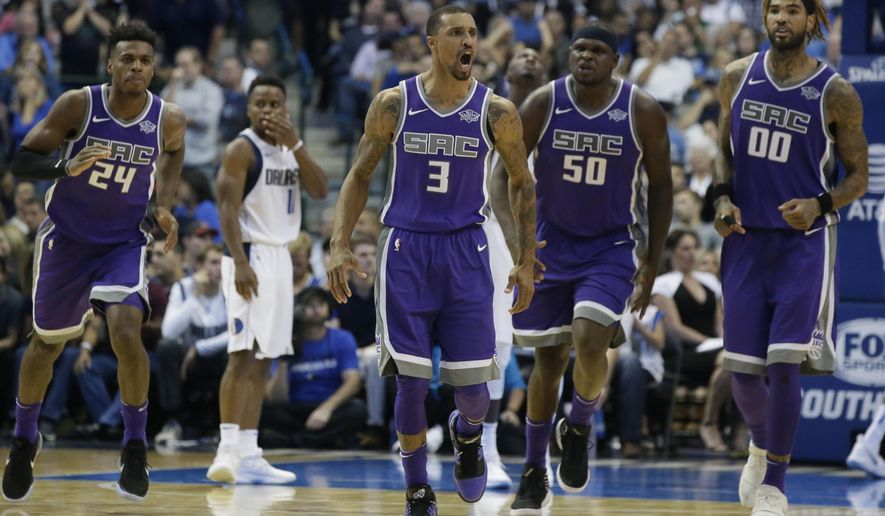 Sacramento Kings guard George Hill (3) reacts to scoring basket as teammates Buddy Hield (24), Zach Randolph (50) and Willie Cauley-Stein (00) follow during the second half of an NBA basketball game against the Dallas Mavericks in Dallas, Friday, Oct. 20, 2017. The Kings won 93-88. (AP Photo/LM Otero)