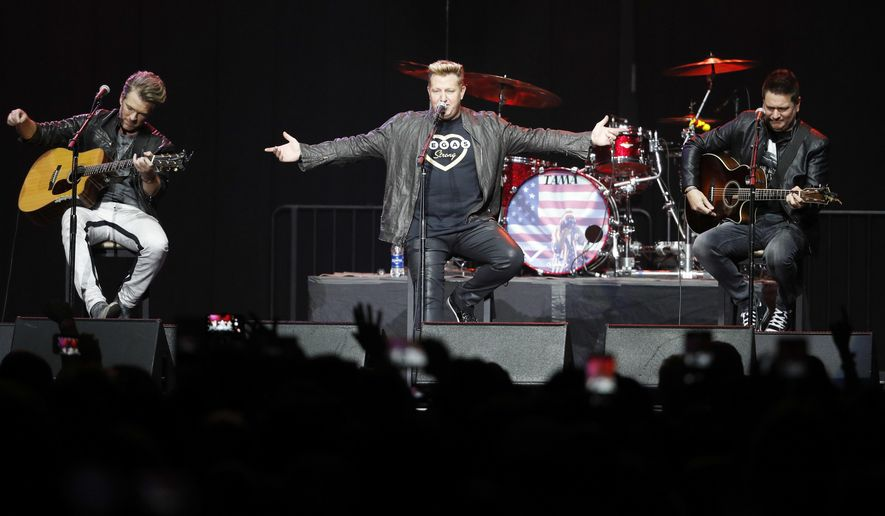 Rascal Flatts performs during a benefit concert honoring first-responders and those affected by the recent mass shooting, Thursday, Oct. 19, 2017, in Las Vegas. Some survivors of the mass shooting said they were ready for closure, though they confessed feeling engulfed by anxiety and security fears while gathering in a large group for the first time. (AP Photo/John Locher)