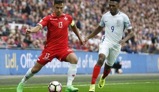 FILE - In this Saturday, Oct. 8, 2016 file photo, England's Daniel Sturridge, right, vies for the ball with Malta's Andre Schembri during the World Cup Group F qualifying soccer match between England and Malta at Wembley stadium in London. Malta national soccer team captain Andre Schembri says the car bomb slaying of a Maltese investigative journalist prompted him not to exult after scoring a historic goal. Schembri's temporary equalizer for Cypriot club Apollon in a 3-1 loss to Italian side Atalanta in the Europa League on Thursday, Oct. 19, 2017 made him the first Maltese player to score in proper European competition, excluding qualifying. (AP Photo/Kirsty Wigglesworth, File)