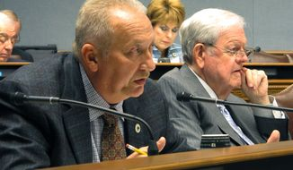 Rep. Jack McFarland, R-Winnfield, asks questions of state health officials about a proposed Medicaid managed-care contract extension during a meeting of the Joint Legislative Committee on the Budget, on Friday, Oct. 20, 2017, in Baton Rouge, La. (AP Photo/Melinda Deslatte)