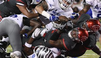 Houston running back Duke Catalon, bottom, falls into the end zone for a touchdown during the first half of an NCAA college football game against Memphis, Thursday, Oct. 19, 2017, in Houston. (AP Photo/Eric Christian Smith)