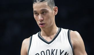 FILE - In this April 1, 2017, file photo, Brooklyn Nets guard Jeremy Lin reacts during the second half of his team's NBA basketball game against the Orlando Magic, in New York. The Nets say Jeremy Lin has had surgery repair a ruptured patella tendon in his right knee and will miss the remainder of the season. The procedure was performed Friday morning, oct. 20, 2017, at the Hospital for Special Surgery in New York (AP Photo/Mary Altaffer, File)