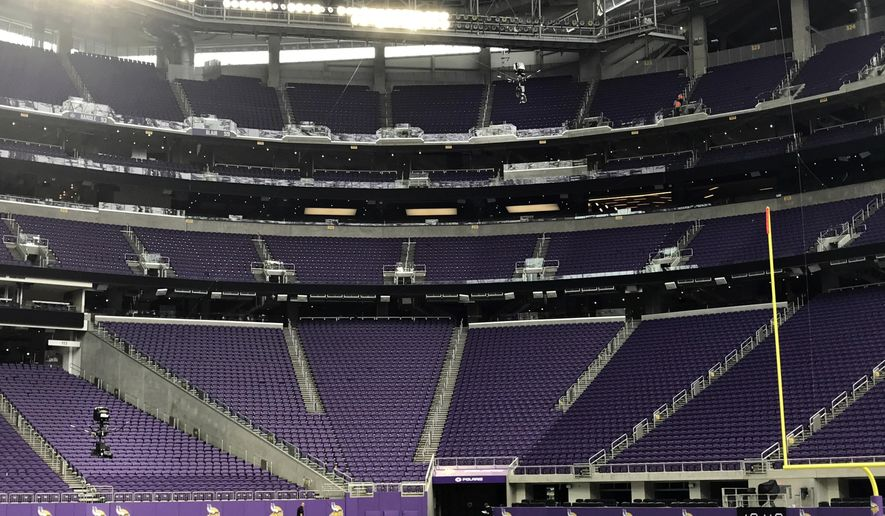 In this Aug. 25, 2017 photo provided by SkyCam, two SkyCam cameras, lower left, and upper right, hang above the NFL football field at U.S. Bank Stadium in Minneapolis.  NBC will unveil a second SkyCam for Sunday night's Super Bowl rematch between the Patriots and Falcons. The original SkyCam used for games flies anywhere from 12 feet to 40 feet above the playing field. The high SkyCam goes from 40 to 80 feet and probably will wind up mostly right in between that height. (Stephen Wharton/SkyCam via AP)