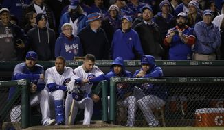 Chicago Cubs players watch from the dugout during the ninth inning of Game 5 of baseball's National League Championship Series against the Los Angeles Dodgers, Thursday, Oct. 19, 2017, in Chicago. (AP Photo/Matt Slocum)