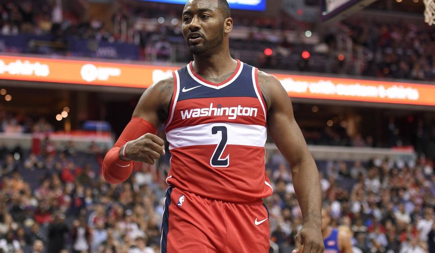 Washington Wizards guard John Wall (2) reacts during the second half of an NBA basketball game against the Detroit Pistons, Friday, Oct. 20, 2017, in Washington. The Wizards won 115-111. (AP Photo/Nick Wass)