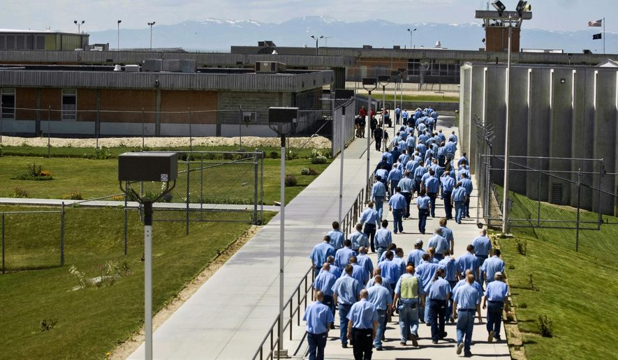 FILE - In this June 15, 2010 file photo, inmates walk to the dinning hall from their cell block at the Idaho State Correctional Institution outside Boise, Idaho. A federal judge says the Idaho Department of Prisons was in contempt of court for a time for failing to follow court orders designed to improve health care for inmates, but the problems appear to have been fixed. The ruling means the state doesn't face any punitive fines for now. More importantly, it means the judge isn't currently planning on extending the amount of time that health care at the Idaho State Correctional Institution remains under federal court oversight. (AP Photo/Charlie Litchfield, File)