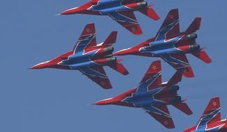 MiG-29 jet fighters of Russian aerobatic team Strizhi (Swifts) perform during ceremony in Batajnica, military airport near Belgrade, Friday, Oct. 20, 2017. Russia has formally handed over six MiG-29 fighter jets to Serbia, part of an arms delivery that could worsen tensions in the war-weary Balkans. (AP Photo/Darko Vojinovic)