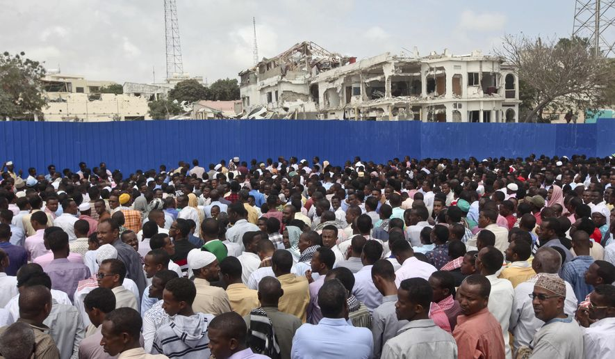 Thousands of Somalis gather to pray at the site of the country's deadliest attack and to mourn the hundreds of victims, at the site of the attack in Mogadishu, Somalia Friday, Oct. 20, 2017. More than 300 people were killed and nearly 400 wounded in Saturday's truck bombing, with scores missing. (AP Photo/Farah Abdi Warsameh)