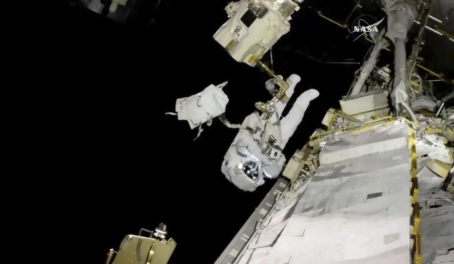 In this image from video made available by NASA, astronaut Joe Acaba performs a spacewalk outside the International Space Station on Friday, Oct. 20, 2017. The 250-mile-high complex is currently home to three Americans, two Russians and one Italian. (NASA via AP)