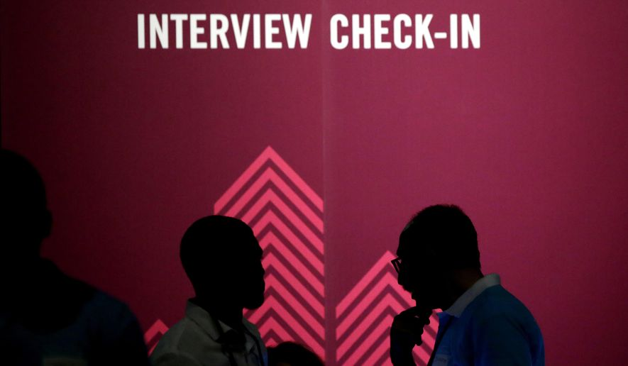 FILE - In this Friday, May 19, 2017, file photo, job seekers chat during the Opportunity Fair and Forum employment event in Dallas. On Friday, Oct. 20, 2017, the Labor Department reports on state unemployment rates for September. (AP Photo/LM Otero, File)