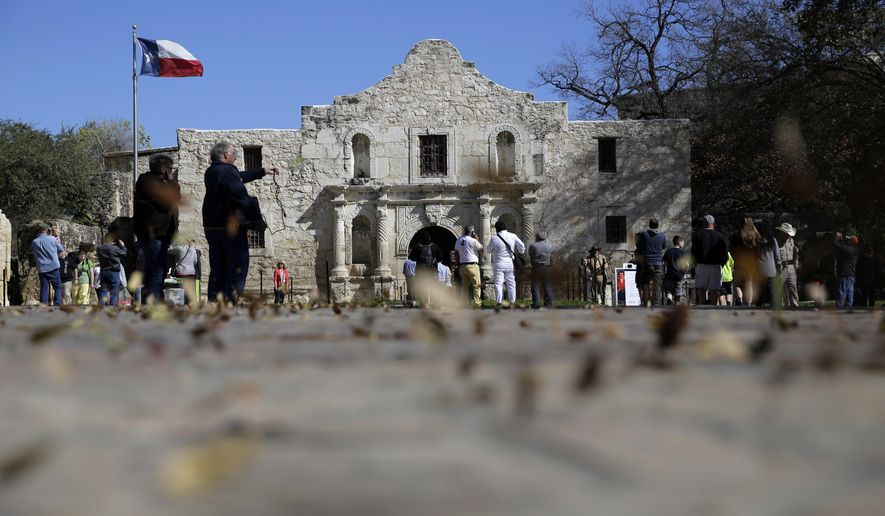 """FILE - In this Feb. 23, 2016, file photo, guests visit the grounds of the Alamo in San Antonio. Texas Land Commissioner George P. Bush is overseeing a 7-year, $450 million revamp of the Alamo, where 189 independence fighters were killed in 1836. That includes restoration of historical structures and building a new museum and visitors' center. But some conservatives worry that the importance of the battle for the Alamo will be marginalized by """"political correctness,"""" with the overhaul sanitizing less-desirable aspects of participants' history, including that some were slaveholders. (AP Photo/Eric Gay, File)"""