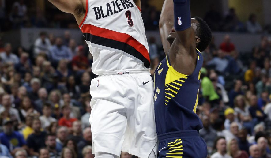 Portland Trail Blazers guard CJ McCollum (3) shoots over Indiana Pacers guard Victor Oladipo (4) during the second half of an NBA basketball game in Indianapolis, Friday, Oct. 20, 2017. The Trail Blazers beat the Pacers 114-96. (AP Photo/Michael Conroy)