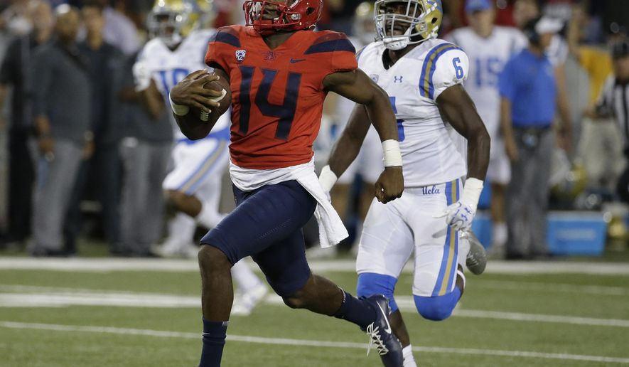 Arizona quarterback Khalil Tate (14) runs for a touchdown against UCLA during the second half ofp an NCAA college football game, Saturday, Oct. 14, 2017, in Tucson, Ariz. Arizona defeated UCLA 47-30. (AP Photo/Rick Scuteri)