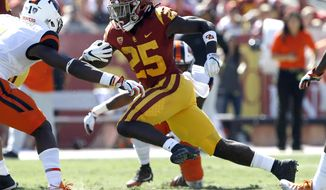 FILE - In this Oct. 7, 2017, file photo, Southern California running back Ronald Jones II (25) runs against Oregon State linebacker Bright Ugwoegbu (1) during the first half of an NCAA college football game in Los Angeles. No. 11 Southern California visits. No. 13 Notre Dame for a showdown on Saturday night. The two quarterbacks are likely to play an important role, but the key players might be the running backs. (AP Photo/Alex Gallardo, File)