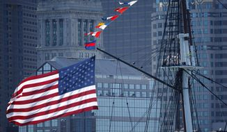 The USS Constitution passes in front of the Boston skyline, Friday, Oct. 20, 2017, in Boston. The newly refurbished ship, nicknamed Old Ironsides, took its first spin since October 2014 to celebrate the 220th anniversary of the iconic vessel's maiden voyage. (AP Photo/Michael Dwyer) ** FILE **