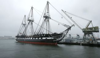 FILE - In this July 24, 2017 file photo, the USS Constitution, also known as Old Ironsides, is docked at the Charlestown Navy Yard, in Boston. The USS Constitution is about to set sail for the first time in three years to celebrate the Navy's birthday and the anniversary of the Constitution's first launch, after it was newly refurbished. The world's oldest commissioned warship will set sail from Charlestown Navy Yard in Boston on Friday, Oct. 20. (AP Photo/Steven Senne, File)