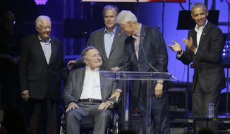 Former Presidents from right, Barack Obama, Bill Clinton, George W. Bush, George H.W. Bush and Jimmy Carter gather on stage during a hurricanes relief concert in College Station, Texas, Saturday, Oct. 21, 2017. All five living former U.S. presidents joined to support a Texas concert raising money for relief efforts from Hurricane Harvey, Irma and Maria's devastation in Texas, Florida, Puerto Rico and the U.S. Virgin Islands. (AP Photo/LM Otero)