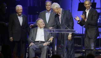 In this file photo, former Presidents from right, Barack Obama, Bill Clinton, George W. Bush, George H.W. Bush and Jimmy Carter gather on stage during a hurricanes relief concert in College Station, Texas, Saturday, Oct. 21, 2017. (AP Photo/LM Otero)