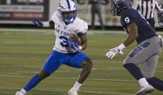 Air Force's Ronald Cleveland cuts back against Nevada's Marcus Lucas (9) during the first half of an NCAA college football game in Reno, Nev., Friday, Oct. 20, 2017. (AP Photo/Tom R. Smedes)