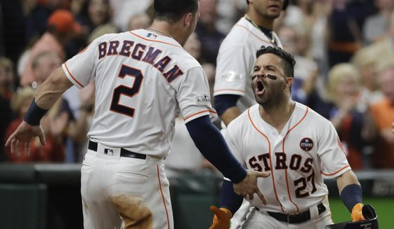 Houston Astros' Jose Altuve is congratulated after hitting a home run during the fifth inning of Game 7 of baseball's American League Championship Series against the New York Yankees Saturday, Oct. 21, 2017, in Houston. (AP Photo/David J. Phillip)