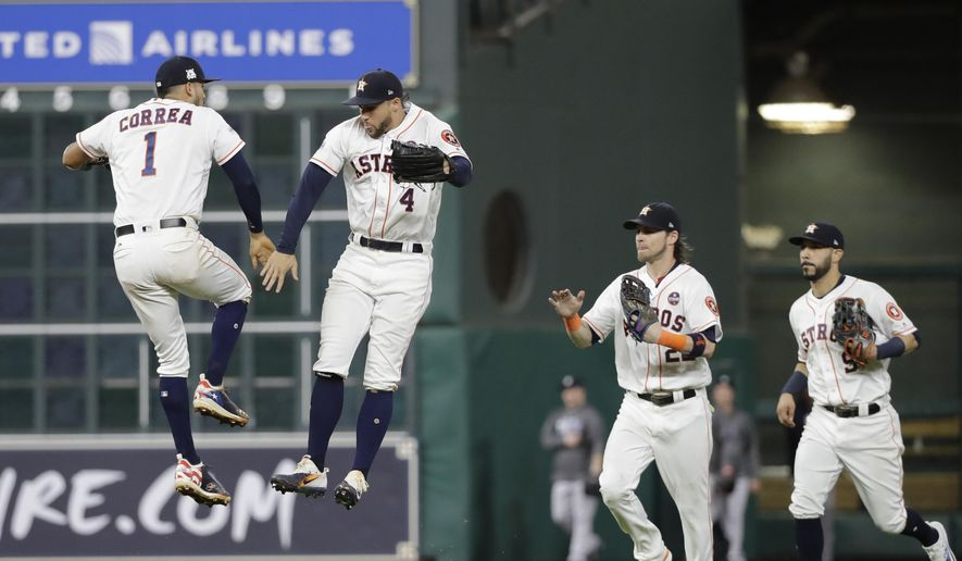 Houston Astros' Carlos Correa and George Springer celebrate after Game 6 of baseball's American League Championship against the New York Yankees Series Friday, Oct. 20, 2017, in Houston. The Astros won 7-1 to tie the series at 3-3. (AP Photo/David J. Phillip)