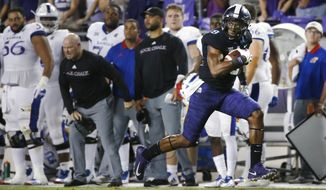 TCU wide receiver John Diarse (9) takes a pass to the end zone to score a touchdown against Kansas during the first half of an NCAA college football game Saturday, Oct. 21, 2017, in Fort Worth, Texas. (AP Photo/Ron Jenkins)