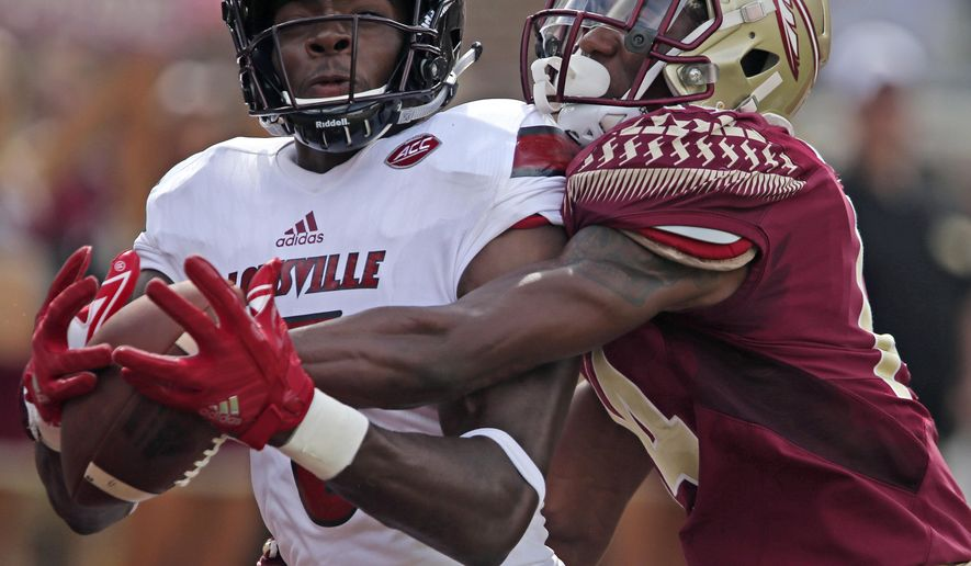 Louisville's Seth Dawkins pulls in a pass for a touchdown as Florida State's Kyle Meyers defends in the second quarter of an NCAA college football game, Saturday, Oct. 21, 2017, in Tallahassee Fla. (AP Photo/Steve Cannon)