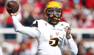 Arizona State quarterback Manny Wilkins (5) passes the ball against Utah in the first half during an NCAA college football game Saturday, Oct. 21, 2017, in Salt Lake City. (AP Photo/Rick Bowmer)