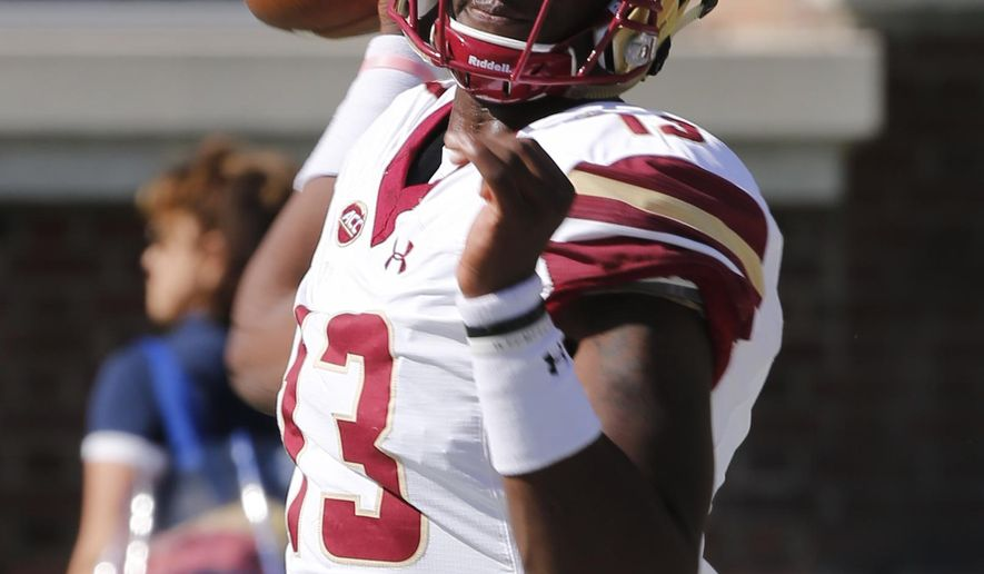Boston College quarterback Anthony Brown (13) warms up prior to the start of an NCAA college football game against Virginia in Charlottesville, Va., Saturday, Oct. 21, 2017. (AP Photo/Steve Helber)