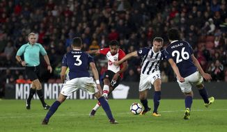 Southampton's Sofiane Boufal, centre, scores his side's first goal of the game,  during the English Premier League soccer match between Southampton and West Bromwich Albion at St Mary's Stadium, in Southampton, England, Saturday, Oct. 21, 2017. (Adam Davy/PA via AP)