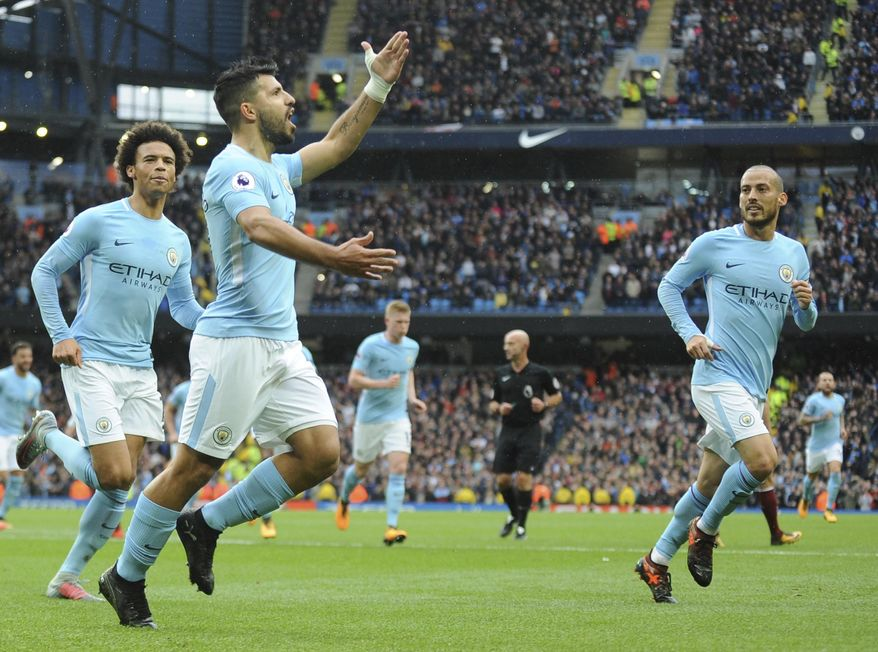 Manchester City's Sergio Aguero, centre, celebrates after scoring during the English Premier League soccer match between Manchester City and Burnley at Etihad stadium, Manchester, England, Saturday, Oct. 21, 2017. (AP Photo/Rui Vieira)