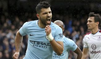Manchester City's Sergio Aguero celebrates scoring his side's first goal from the penalty spot, equaling Manchester City's all-time scoring record, during the English Premier League soccer match between Manchester City and Burnley, at the Etihad Stadium, in Manchester, England, Saturday, Oct. 21, 2017. (Martin Rickett/PA via AP)